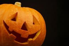 Jack-o-lantern. Halloween funny Jack-o-lantern over black background Royalty Free Stock Images
