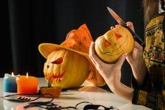 Jack`o`lantern halloween pumpkin in hands royalty free stock image