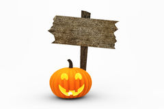 Jack-O-Lantern and Large Wooden Sign Stock Images