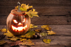 Jack-o-lantern with leaves Royalty Free Stock Image