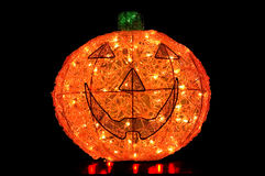 Jack-O-Lantern Lit Up on Black Background Royalty Free Stock Image