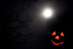 Jack-o-lantern in night. Against full moon royalty free stock image
