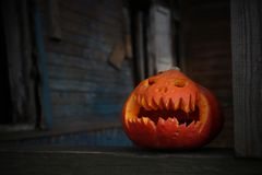 Jack o lantern in old house during the halloween royalty free stock photography