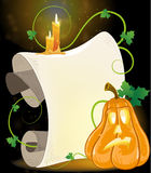 Jack o Lantern, parchment and burning candles Royalty Free Stock Images