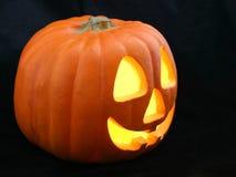 Jack-O-Lantern Profile on Black. A profile view of a Halloween Jack-O-Lantern on a black background royalty free stock image