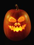 Jack-o-lantern pumpkin. Lit Jack-o-lantern pumpkin on black background Royalty Free Stock Image