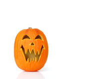 Jack O Lantern Pumpkin. A carved jack o lantern pumpkin isolated on white with space for copy Royalty Free Stock Image