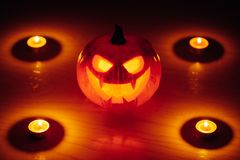 Jack-o-lantern pumpkin candle fire light, Halloween background. Closeup view Stock Images