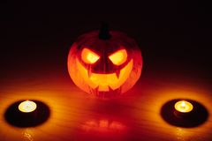 Jack-o-lantern pumpkin candle fire light, Halloween background royalty free stock image