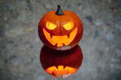 Jack-o-lantern pumpkin candle light, gray background royalty free stock photo