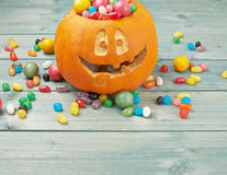 Jack o lantern pumpkin filled with candies Royalty Free Stock Photos