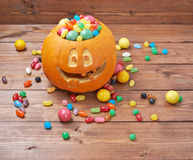 Jack o lantern pumpkin filled with candies Stock Photo