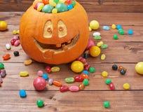 Jack o lantern pumpkin filled with candies Royalty Free Stock Image