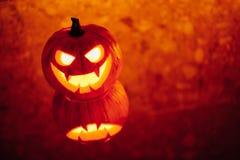 Jack-o-lantern pumpkin glow light, Halloween background. With copy-space Royalty Free Stock Image