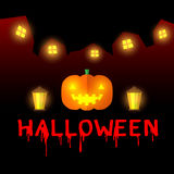 Jack-o-lantern pumpkin head with lantern in night village Stock Photo