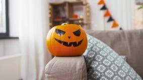 Jack-o-lantern pumpkin at home on halloween stock video footage