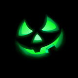 Jack O Lantern pumpkin illuminated green. EPS 8 Stock Photography