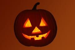Jack-O-Lantern Pumpkin with Orange Background Royalty Free Stock Images