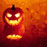 Jack-o-lantern pumpkin orange light, Halloween background royalty free stock images