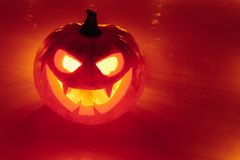 Jack-o-lantern pumpkin orange light, Halloween background stock image
