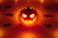 Jack-o-lantern pumpkin with spiders, Halloween background. Jack-o-lantern pumpkin with spiders and glow light, Halloween background Royalty Free Stock Photography