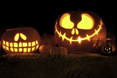Jack o Lantern Pumpkins on Cobweb Fabric Stock Image