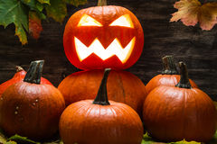Jack o lantern on pumpkins pile Stock Photo