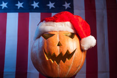 Jack-o '- lantern in a red Santa hat Royalty Free Stock Image