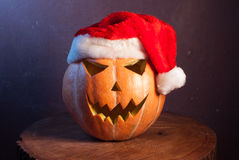 Jack-o ' - lantern in a red Santa hat, Stock Images