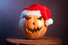 Jack-o ' - lantern in a red Santa hat, Stock Photos
