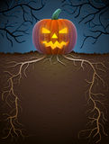 Jack-o-lantern with roots in night lighting Royalty Free Stock Photo