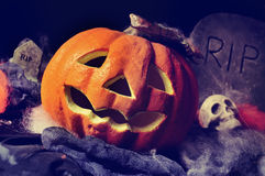 Jack-o-lantern, skulls and gravestones Royalty Free Stock Photo