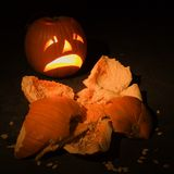 Jack-o'-lantern with smashed pumpkin. Royalty Free Stock Photo