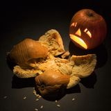 Jack-o'-lantern with smashed pumpkin. Royalty Free Stock Photos