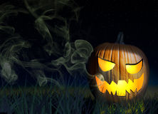Jack o'lantern on a spooky night background. Halloween Pumpkin On A Spooky Background At Night Royalty Free Stock Images