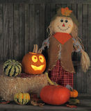 Jack-o-lantern and Straw Doll Royalty Free Stock Photo