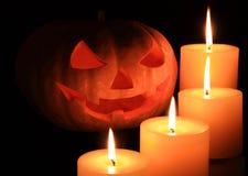 Jack o'lantern surrounded by candles. Jack O' Lantern surrounded by candles Stock Images