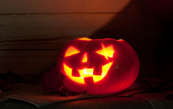 Jack O' Lantern. On a table on a dark background. Pumpkin carved for Halloween Stock Images