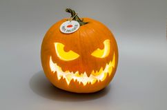 Jack-o` lantern with tag. royalty free stock images