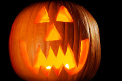Jack-o-lantern up close. Vampire jack-o-lantern face outside at night Stock Photography