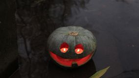 Jack-o-lantern in the water stock video footage