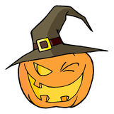 Jack o lantern wearing a witch hat winking Royalty Free Stock Images