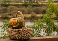 Jack-O-Lantern in wicker basket Stock Photos