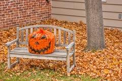 Jack O Lantern on a Wood Bench Royalty Free Stock Photography