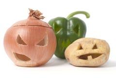 Jack-o-Lanternas feitas fora da fruta e verdura Fotografia de Stock
