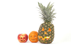 Jack-o-Lanternas feitas fora das frutas Fotos de Stock