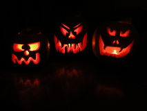 Jack-O-Lanterns. 3 pumpkins carved with scary faces for Holloween Royalty Free Stock Photos