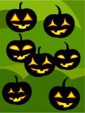 Jack o' lanterns. Many jack o' lanterns over green background. Halloween Stock Photo