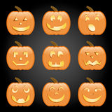 Jack-O-Lanterns. Nine jack-o-lanterns, each with a different face, perfect for Halloween Royalty Free Stock Photos