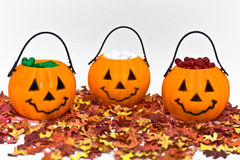 Jack-o-Lanterns. Jack-o-lantern candy containers with leaves on white background Stock Image